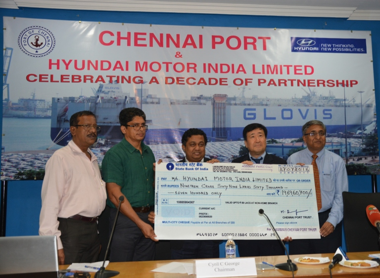 Mr. Cyril C George, Chairman-Chennai Port Trust handing over the cheque ...