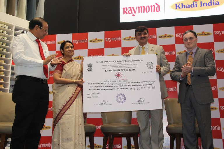 Khadi Mark certificate being given to Raymond Ltd. by KVIC