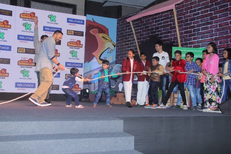 The ace director Rohit Shetty playing tug of war with the kids of selected Police officers at the launch of Discovery kids upcoming show 'Little Singham'.JPG
